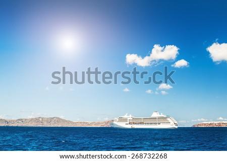Cruise ship near the Greek Islands. Santorini island, Greece. Beautiful summer seascape - stock photo