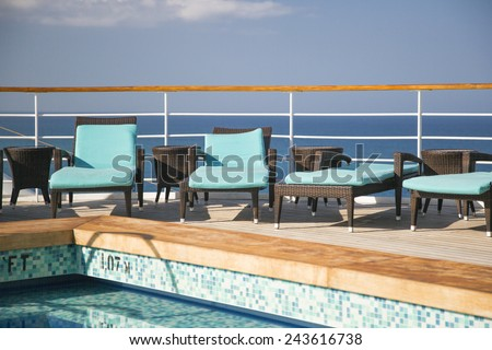 Cruise Ship, Ocean, Lounge Chairs And Swimming Pool Abstract. - stock photo
