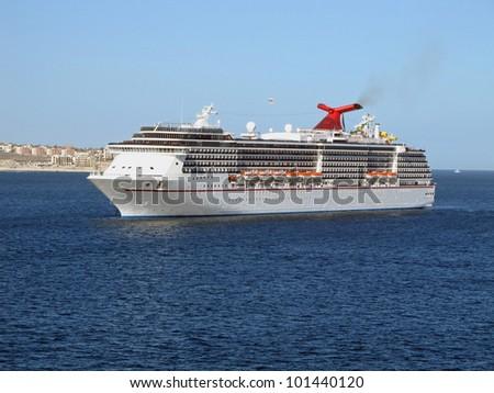 Cruise ship off the coast of Cabo San Lucas, Mexico. - stock photo