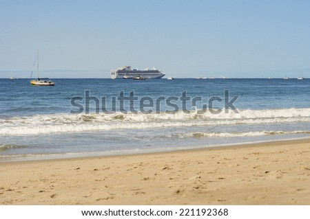Cruise ship off the coast of California with other boats - stock photo