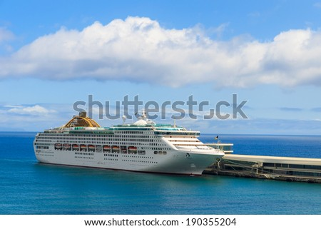 Cruise ship on sea in Funchal port, Madeira island, Portugal