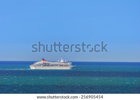 Cruise Ship On The Open Sea - stock photo