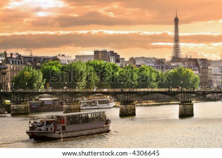 Cruise ship on the Seine river in Paris, France. - stock photo