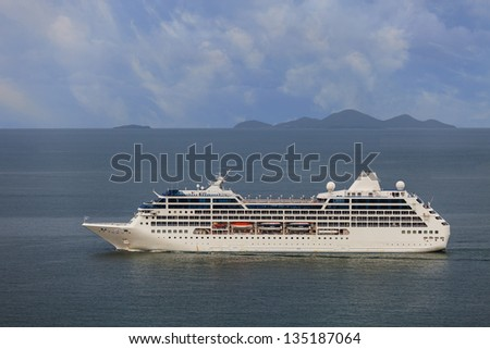Cruise ship passengers are free to travel back from sailing vacation - stock photo