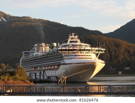 Cruise ship starting to depart from port in Juneau Alaska in the soft evening light - stock photo
