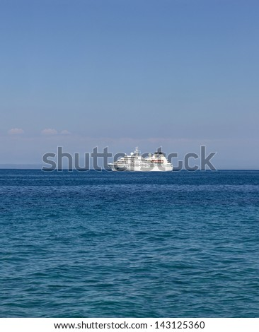 cruise ship traveling in the blue sea