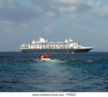 cruise ship with tender (small transport boat) heading towards it