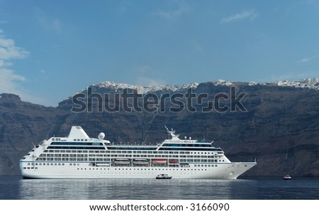 Cruise ship with the cliff line of a mediterranean island