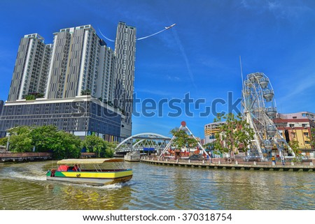 Cruise tour boat sails on the River near the city. Tourism Concept - stock photo