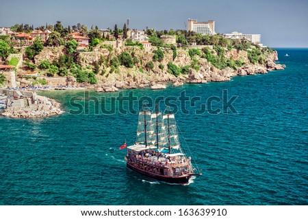 Cruise touristic ship  and view of Antalya city, Turkey - stock photo