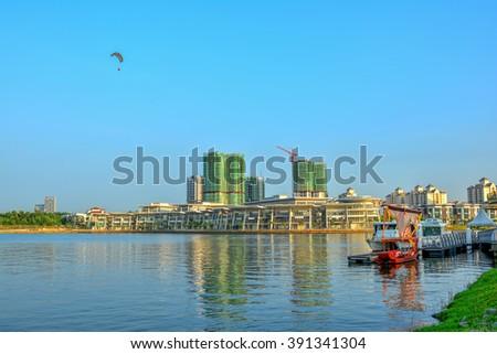 """Cruise with boat """"Dondang Sayang"""" park at jetty, Putrajaya Lake, Malaysia - stock photo"""