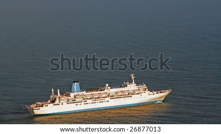 cruiser on the sea for a pleasure travel - stock photo