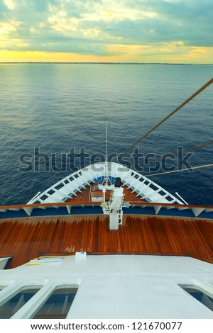 cruising on ocean liner, point of view from the upper deck
