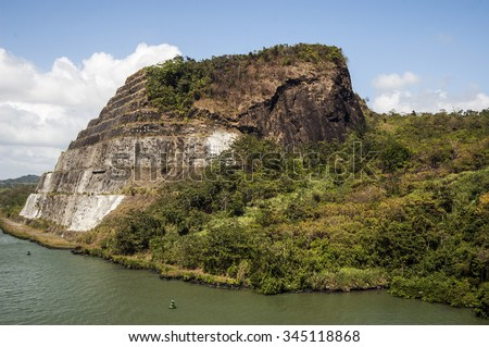 Cruising to Panama Canal mountain. - stock photo