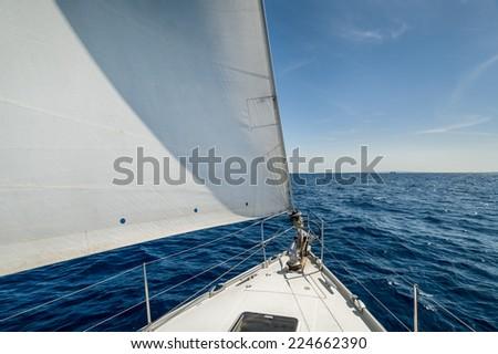 Cruising yacht bow with hoisted sails. Balearic islands, Spain - stock photo