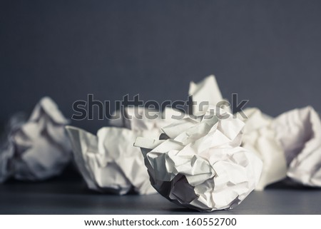 Crumble paper balls on gray ground - stock photo