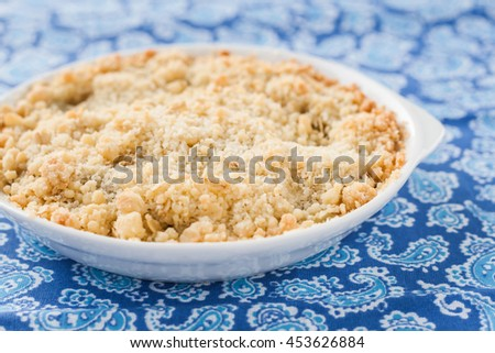 crumble with rhubarb and apple. - stock photo