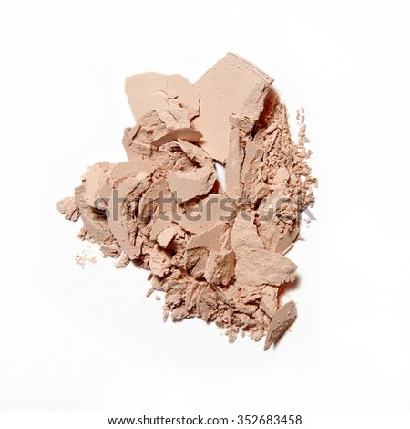 crumbled natural powder on white background - stock photo