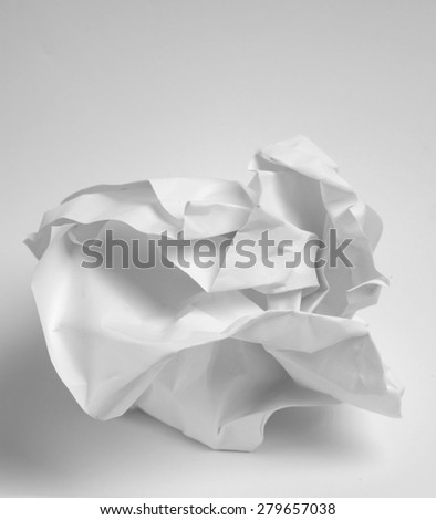 Crumbled up paper on white background