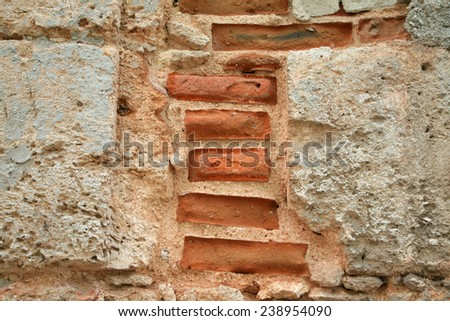 Crumbling wall in Havana with red brick and concrete - stock photo
