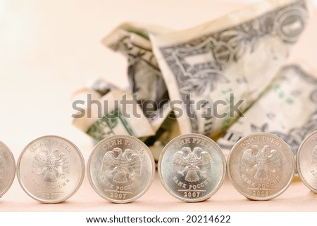 Crumbpled dollars under coin protection