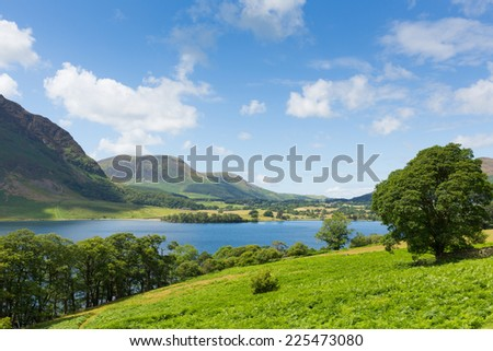 Crummock Water Lake District Cumbria England UK between Buttermere and Loweswater on summer day with blue sky and white clouds - stock photo