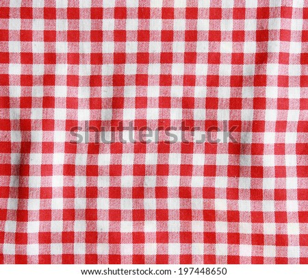Crumple texture of a red and white checkered picnic blanket. Red linen tablecloth.