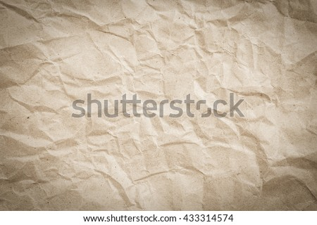 crumpled art plain paper texture background vignette in vintage tan color cream tone:detail of crease crinkle of paper texture.art soft brown sepia color wallpaper pattern:rugged carton craft backdrop - stock photo