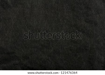 Crumpled black paper background. - stock photo