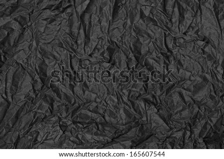 Crumpled black paper background - stock photo