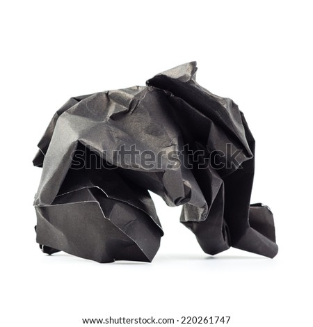 Crumpled black paper ball isolated on white background
