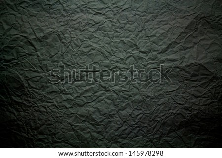 Crumpled black paper for background - stock photo