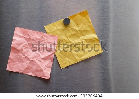 CRUMPLED BLANK PAPER NOTE ON STAINLESS STEEL REFRIGERATOR DOOR  - stock photo