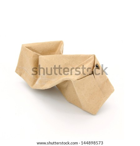 Crumpled Brown paper milk carton isolated on white background