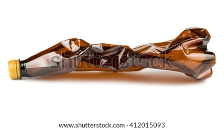 Crumpled brown plastic bottle isolated on white background