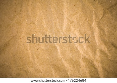 Crumpled brown recycle paper background.