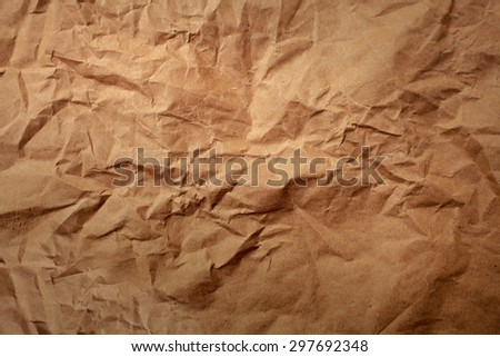 Crumpled brown recycle paper for texture background