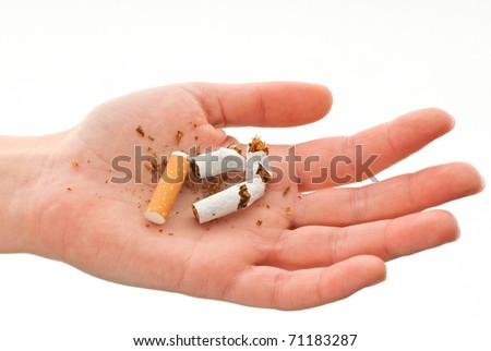 Crumpled cigarette in one hand against a white background