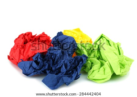 Crumpled colored napkin paper isolated on white background