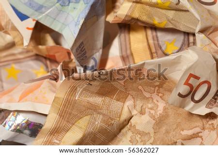 Crumpled euro bills closeup, currency crisis concept - stock photo