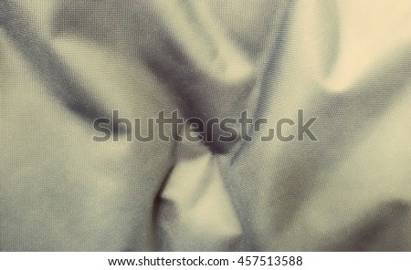 Crumpled fabric texture, cloth background.
