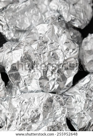 crumpled foil on a black background