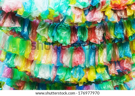 Crumpled garbage bag then put into a beautiful background. - stock photo