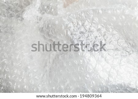 Crumpled heap of used bubble wrap plastic - stock photo