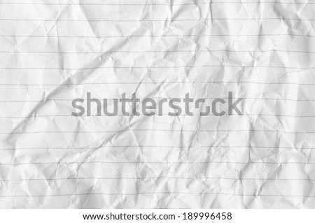 Crumpled lined paper as background. - stock photo