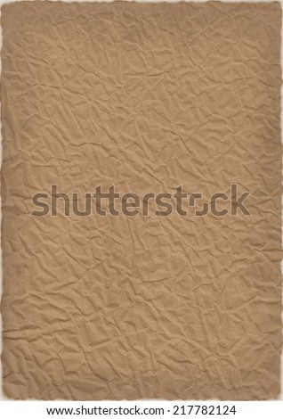 Crumpled old aged paper with burned edges - stock photo