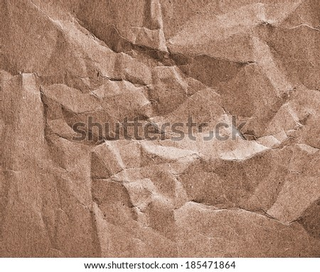 crumpled packaging paper closeup - abstract background - stock photo