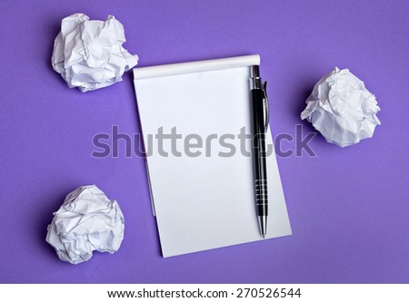 Crumpled paper and notepad on background - stock photo