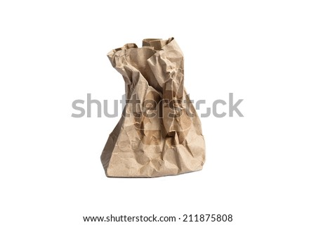 Crumpled paper bag standing with recycle logo on white background - stock photo