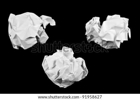 Crumpled paper ball isolated on a black background - stock photo